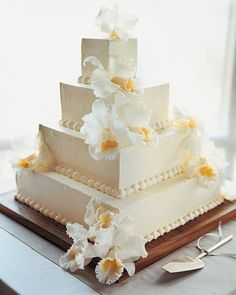 This airy and moist vanilla sponge cake has a thin layer of apricot jam inside and is covered with buttercream; piped dots and fresh cattleya orchids lend elegance. In a nod to this wedding's tropical Bahamas location, the cake board was cut from teak (the cake itself rests on a cardboard layer).