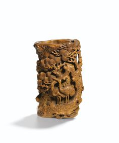 AN EXQUISITELY CARVED BAMBOO ROOT 'CRANES AND PINE' BRUSHPOT<br>QING DYNASTY, 18TH CENTURY | Lot | Sotheby's