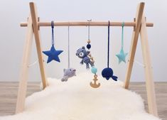 Nautical baby gym. Wooden baby gym with five crochet maritime baby gym toys. Bear the sailor, dolphin, whale, stars. Blue, grey, navy, mint. by LanaCrocheting on Etsy https://www.etsy.com/listing/516096666/nautical-baby-gym-wooden-baby-gym-with