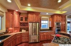 Gourmet kitchen... wine rack, island kitchen, granite... look at the painted ceiling featured by crown molding... Oregon Dream Home