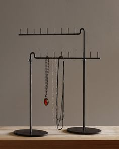Once used for bow tie displays in a men's haberdashery the Louis cravat stand works equally well for jewelry displays. The iron rods are adjustable for on top of a counter or even inside a showcase. A