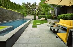 The back garden is both minimalist and comfortable. Landscape architect David Pfeiffer designed the paving and plantings, and interior designer Elisabeth Sandler chose the fabrics and furniture. (Benjamin Benschneider/The Seattle Times)