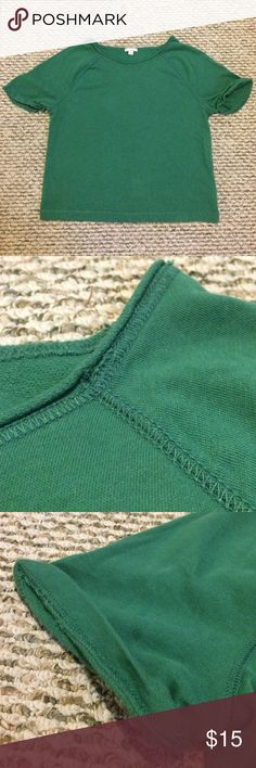 Cuffed Short Sleeve Sweatshirt Thin 100% cotton sweatshirt material top with decorative stitching on the neck, arms and hem of the top. The top also has rolled sleeves. Color resembles a bright kelly green to add a pop of color to any outfit GAP Tops Tees - Short Sleeve