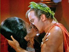 The first interracial kiss on TV.  Nichelle Nichols as Uhura and William Shatner as Captain James Kirk, Star Trek (1966-68).