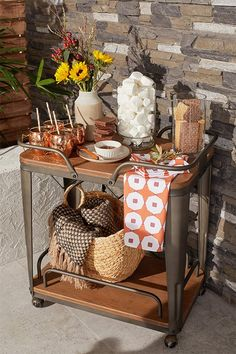Display decor and serve treats with a beautiful bar cart from Overstock!