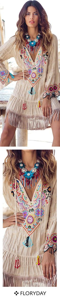 Pretty! Ethnic, Bohemian, or hippie-style dress and necklace.
