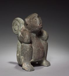 A Monkey, 1325-1519 Central Mexico, Tacuba, Aztec, Post-Classic Period stone, Overall - h:24.50 w:14.50 d:20.50 cm (h:9 5/8 w:5 11/16 d:8 1/16 inches). Gift of William Ellery Greene 1959.125