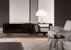 The Land sideboard designed by Rodolfo Dordoni and produced by Minotti. The wood veneer of Ebony Ammara is used to stress the utmost luxury. by fineline_wood Low Sideboard, Dining Room Sideboard, Dining Table, Furniture Decor, Furniture Design, Traditional Cabinets, Space Dividers, Italian Furniture, Glass Shelves
