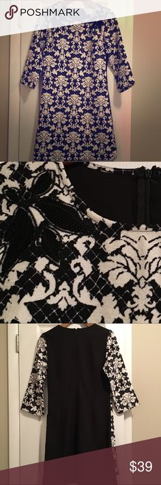 Beautiful Black/White Dress NWOT Black/White Dress is absolutely stunning! 3/4 length sleeves and it's the perfect length for any EVENT! Mesh flower cutout detailing around the neck. Shell: 100%Cotton, Contrast: 96%Polyester 4%Spandex; Care Instructions - Hand wash, lay flat to dry Dresses Midi