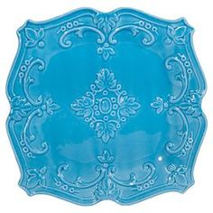 "Turquoise ceramic salad plate with scrolling detail.   Product: Salad plateConstruction Material: CeramicColor: Turquoise Features: Elegant scroll motifDimensions: 1 H x 8"" W x 8"" DCleaning and Care: Dishwasher safe"