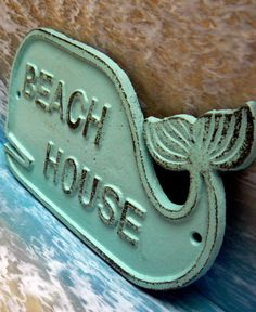 """Whale Beach House Sign Wall Decor Nautical Beach Coastal  7 5/8"""" Long x 4 1/2"""" Tall x ¼"""" thick  Painted a light beach blue  Distressed to create the shabby/cottage chic look  As when you paint cast iron it may leave rough spots in the finish"""