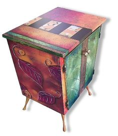 Slightly overdone; in my opinion - but I like the idea of working with various inlay, patinas and enameling to create a stand-alone piece. I simply like to thinkt hat a $1500 piece of furniture would have a bit more sophistication to it...  Artist: Wendy Grossman