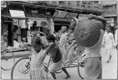 Street scene with children.. From Duke Digital Collections. Collection: William Gedney Photographs and Writings. Mark: Stamp. Date of print: 1974.