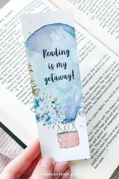"""You can never have too many bookmarks... right?! I love starting a new read with a matching bookmark almost as much as I love designing them for my favourite reads. """"Reading is my getaway"""" – do you agree? Nothing like getting lost in a good book. Click if you want to get this printable bookmark for yourself or as a book loves gift for your book buddy / favourite bookworm! Creative Bookmarks, Diy Bookmarks, How To Make Bookmarks, Bookmarks For Books, Homemade Bookmarks, Reading Bookmarks, Printable Bookmarks, Watercolor Bookmarks, Watercolor Art"""