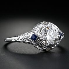This Art Deco gem of a ring features a glistening carat old European-cut diamond flanked on each side by a calibre-cut synthetic sapphire (completely original to the ring) and flanked on the top and bottom by a twinkling old European-cut diamond. Best Diamond, Diamond Cuts, Vintage Engagement Rings, Diamond Engagement Rings, Art Nouveau, Art Deco Diamond, European Cut Diamonds, Diamond Are A Girls Best Friend, Ring Designs