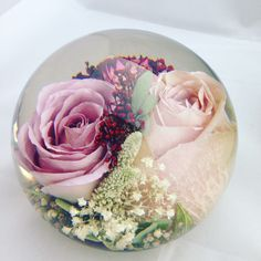 Your memories of your bridal bouquet encapsulated forever within a beautiful paperweight of your choice of design
