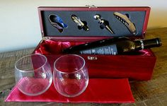 This beautiful Rosewood Finish Wine Presentation Box makes a perfect addition to any wine connoisseur's collection. This makes a perfect gift for Birthdays, Anniversaries, Holidays, Weddings, House Warming, etc.  -Rosewood Finish Wine Presentation Box includes 4 piece wine tool kit with foil cutter, decanter, stopper, and corkscrew.   - Rosewood finish box is lined with a beautiful satin red lining and holds a standard bottle of wine.