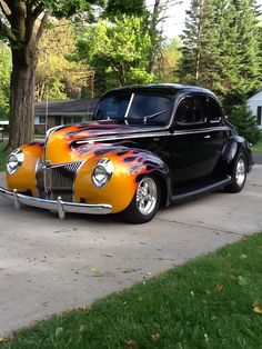 This is a 40 Standard Ford Coupe, SBC built 355, 350 tranny.  Black with House of Color flames. Bought it in 2012, still have it.