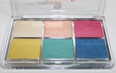 Essence Eyeshadow Palette in All About Paradise  Swatches & review of the Essence All About Candies, Nude, Sunrise, & Paradise Eyeshadow Mini Palettes. You can purchase these from ULTA & they contain varying matte, satin, & metallic shades! Read more on All Things Beautiful XO | www.allthingsbeautifulxo.com