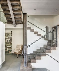My favorite shot of this house. I love the mixture of texture: fir beams mixed with the metal railing with glass panels and steel posts in a grinder finish.