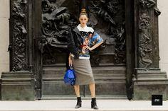 Teddy Quinlivan wearing a Prada shirt and a Loewe bag during Paris Fashion Week Spring Summer 2017