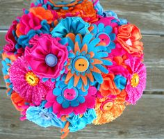 Aqua Orange and Pink Button Wedding Bouquet...cute idea to try for the throwing bouquet!