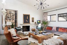 From the chandelier to the cowhide to poufs, this room screams grand.
