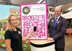 Norfolk Food and Drink Festival chairman Richard Woolliams and Cara Collins from Little Melton Yoghurt with the festival's new QR code.