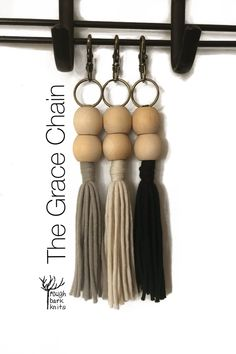Simple boho chic. Bag charm, keychain, zipper pull. Made with flowing cotton/nylon tassels & a sturdy bronze-coloured lobster clasp. Wooden Beads, Lobster Clasp, Knits, Bobby Pins, Boho Chic, Tassels, Hair Accessories, Bronze, Zipper