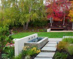 fontaine-jardin-béton-bassin-revêtu-plaquettes-pierre