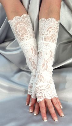 They are made of stretchy spandex fabric with lace cuffs.One Size will fit small, small to medium and medium handL/XL will fit large, large to extra large and extra large hand Lace Cuffs, Lace Gloves, Fingerless Gloves, White Gloves, Mode Mori, Hand Socks, White Spandex, Wedding Gloves, Black Lace Tops