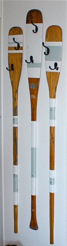 Love this Oar coat hook DIY you recommended, but not sure where you could hang them.  Consider using one oar horizontally under the screen next to the porch door.  You could mount hooks along the handle of the oar.  The towels would hang below the screen window,