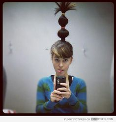 """Crazy hair day contest winner - Funny hair looking like tower on the head of a girl who won the """"crazy hair"""" contest at work."""