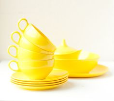 Bright yellow cups and saucers