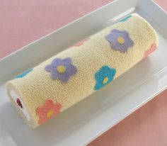 Decorated Sponge Cake Roll  Looks like a decorative water noodle, but could be fun to make...maybe...