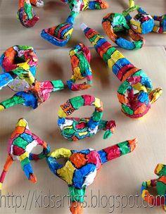 from Kids Artists blog: papier mache sculptures In the style of Niki de Saint Phalle.