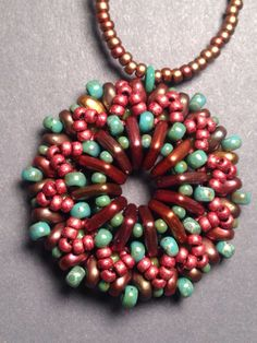 Side two of a reversible seed bead woven pendant. Beth Stone