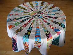 Great Tutorial on how to make ROUND, quilted tablecloth or treeskirt OUT OF SCRAPS! Can't wait to try this:)