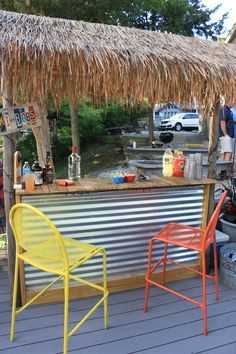 28ac26770b6e Tiki Bar built from pallet wood and a few 2x4's. Corrugated metal front and  some