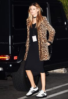 Behati Prinsloo went a little rocker pairing her LBD with a leopard coat, choker and sneakers