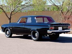 '64 Plymouth Savoy HEMI. Grab your little mustang or camaro or whatever and I'll drag you any day in this