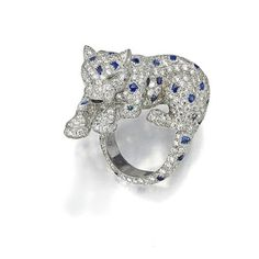 "A DIAMOND, SAPPHIRE AND EMERALD ""PANTHER"" RING, Cartier - US$ 60,000 - 80,000 at Bonhams"