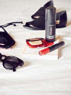 Go for a bright red lip this summer with L'Oreal Infallible and all black accessories.
