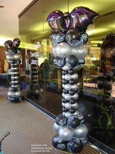 Love these Halloween balloon columns with a big bat perched on top! Black and white with silver and a touch of purple is perfect for a classy party. Design by Nadia Azar, CBA, of Balloontastic Creations in Rockaway, NJ, USA Balloon Tower, Balloon Stands, Balloon Display, Balloon Columns, Balloon Decorations Party, Balloon Ideas, Halloween Balloons, Theme Halloween, Halloween Trick Or Treat