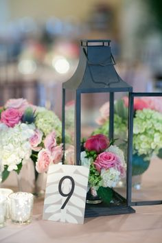 lantern and floral centrepieces  Read More: http://www.stylemepretty.com/2014/07/03/classic-pastel-hued-affair-in-key-west/