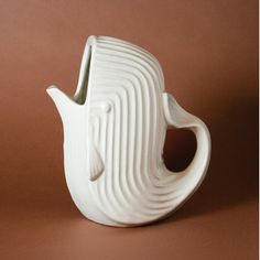 Features:  -Whale pattern.  -High-fired stoneware.  -With a matte white glaze.  Product Type: -Pitcher.  Craftsmanship: -Hand Blown.  Material: -Stoneware.  Color: -White.  Dishwasher Safe: -Yes.  Sty