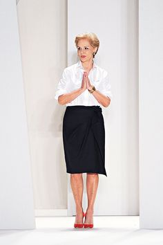 Carolina Herrera herself...ALWAYS in a classic white blouse and black skirt. Every season, I look at HER fashions FIRST.