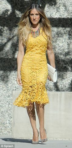 Back to her Carrie best: Sarah Jessica Parker was seen posing in flirt, feminine dresses for Brazilian clothing brand Maria Valentina's Spring/Summer 2014 collection on Tuesday in Beverly Hills, California