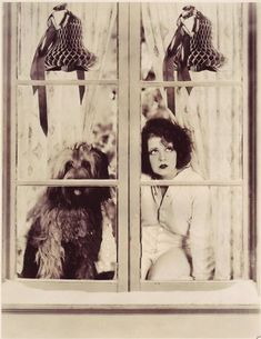 """""""A Hollywood girl who still believes in Kris Kringle! Clara Bow knows that if she and her watch-dog just manage to stay awake they'll be rewarded.""""    A page from Photoplay Magazine"""
