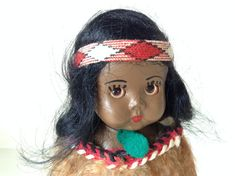 Vintage Maori Doll from NZ, stands approximately 16 cm, in full Maori dress, collectable